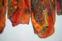 Detail of Fire, textile art by Joanne Weis